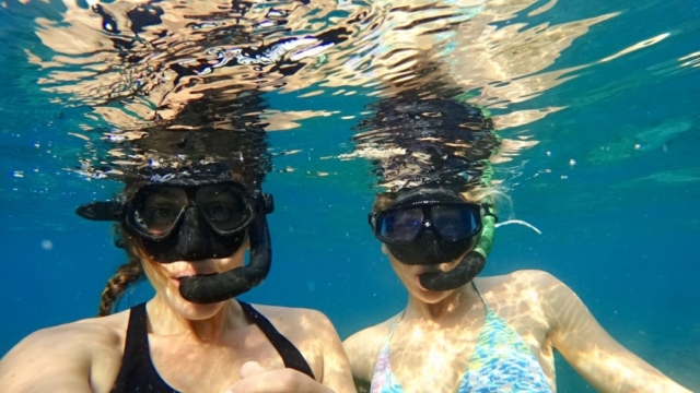 Two mermaids enjoying beautiful Amed Bali