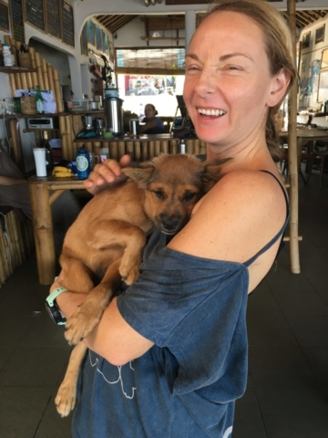 Cute puppy being cuddled in Apneista Amed Bali