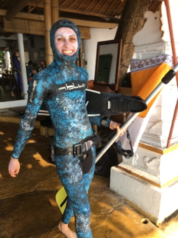 Freediver ready for the water with sunblock and fins in Apneista Bali Amed