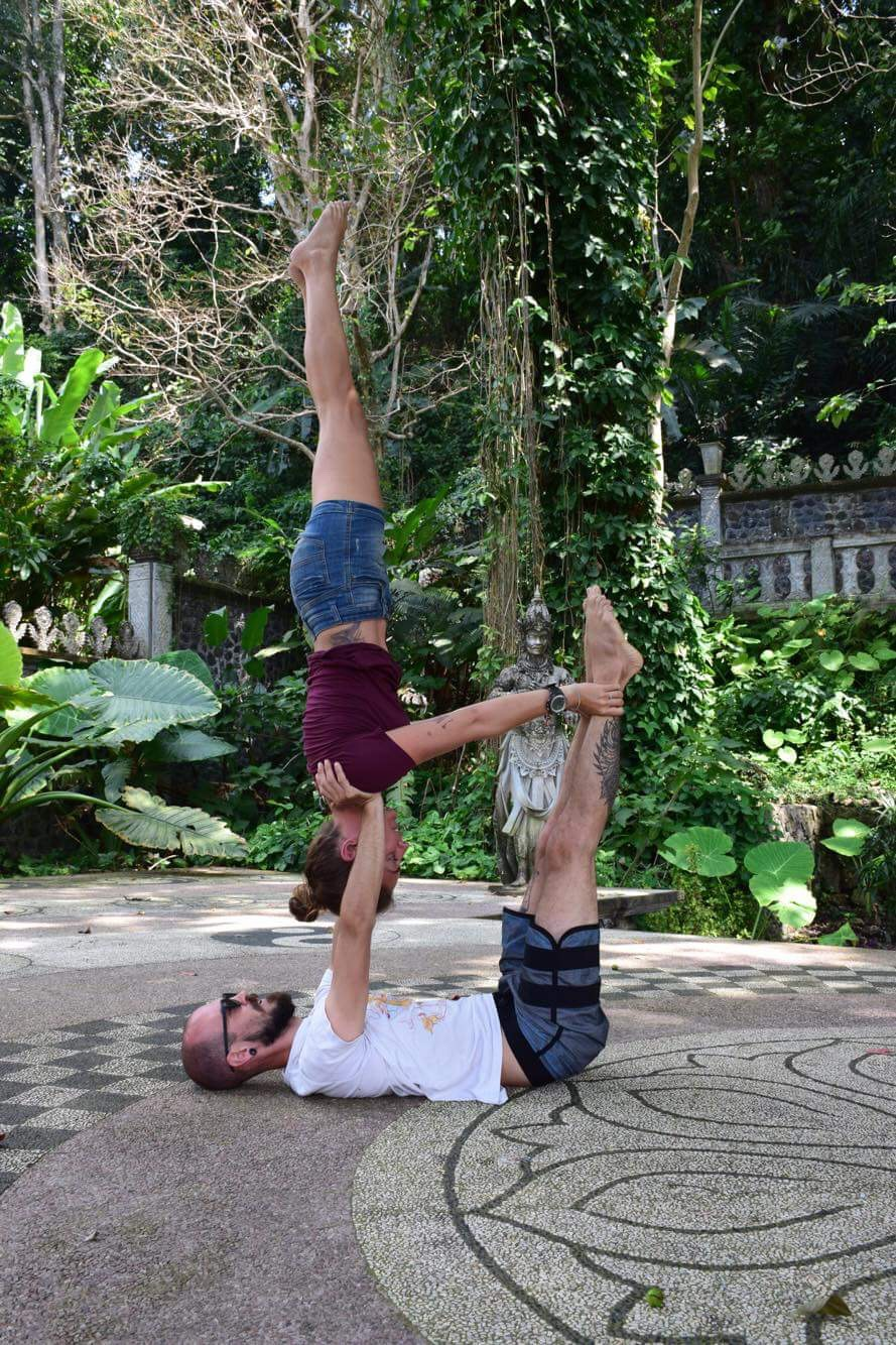 Acro yoga at Tirta Gangga temple in Amed Bali