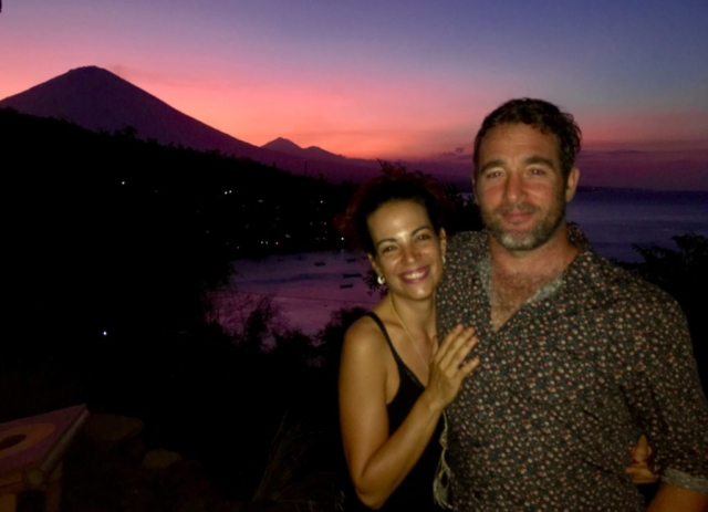 Beautiful couple enjoying sunset behind Mt. Agung in Amed Bali, Blue Earth Village