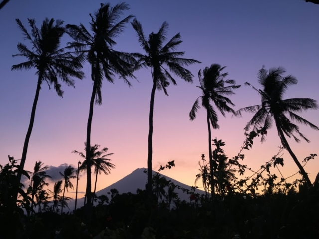 Beautiful sunset behind Mt. Agung in Amed Bali